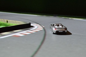 Image of an RC car on a racing track.